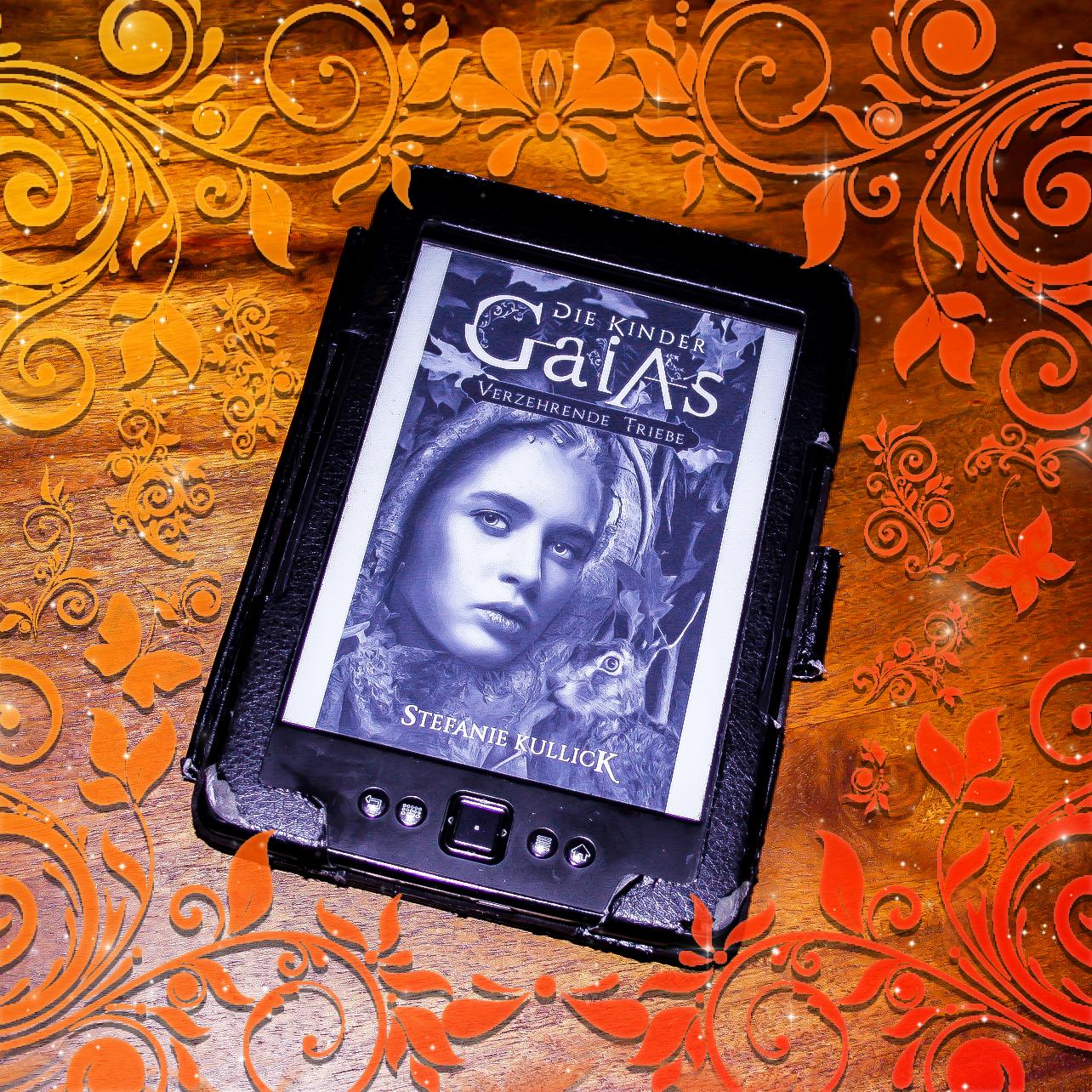 Bild vom Kindle, der das Cover von Die Kinder Gaias: Verzehrende Triebe von Stefanie Kullick zeigt. Passend zur Rezension gestaltet.